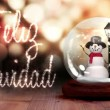 Snowman inside snow globe with christmas greeting in spanish — Stock Video #61019873