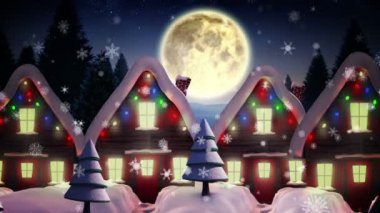 Santa flying over cute snowy village — Stock Video