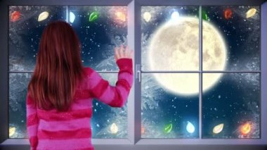 Little girl waving to santa flying past full moon — Stock Video
