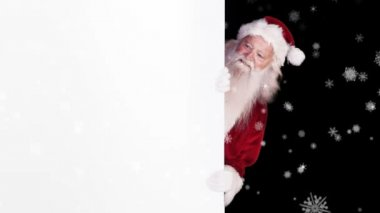 Santa peeking around gift card on festive background — Stock Video