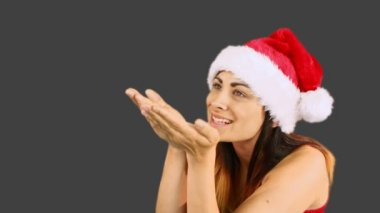 Festive brunette blowing over hands — Stock Video