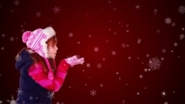 Festive little girl blowing magical christmas greeting — Stock Video