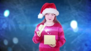 Festive little girl opening magical christmas gift — Stock video