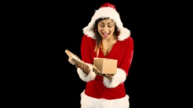 Sexy girl in santa costume opening a gift — Stock Video