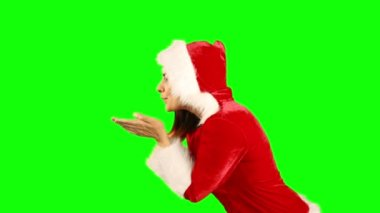 Girl in santa hat blowing over hands — Stock Video