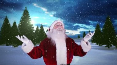 Santa raising his hands against snowy fir forest — Stock Video