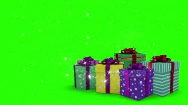 Christmas presents appearing on green background — Stock Video
