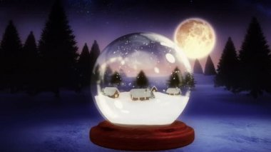 Christmas village inside snow globe with flying santa — Stock Video