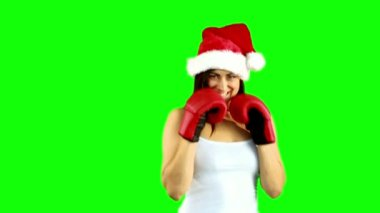 Festive brunette boxing to camera — Stock Video