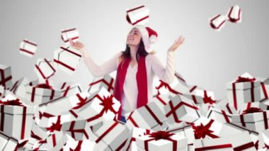 Festive brunette with falling christmas presents — Stock Video