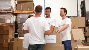 Warehouse workers packing up donation boxes — Stock Video