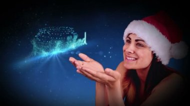Festive brunette blowing a magical christmas greeting — Stock video