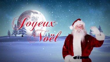 Santa waving at camera with joyeux noel message — Stock Video