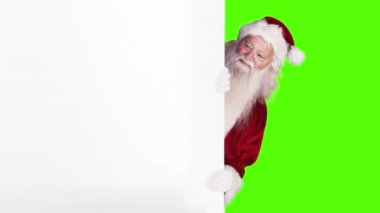 Santa peeking around gift card on green screen background — Stock Video