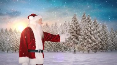 Santa presenting against snowy fir forest — Stock Video