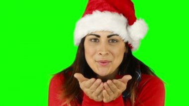 Festive brunette in santa hat blowing over hands — Stock Video