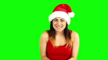 Pretty girl in santa hat sending an air kiss to camera — Vídeo Stock