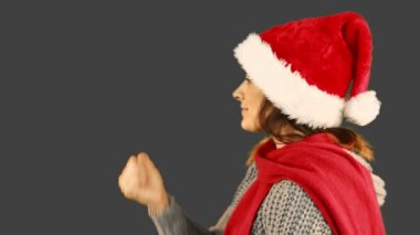 Girl in santa hat and warm clothing blowing over hands — Stock Video
