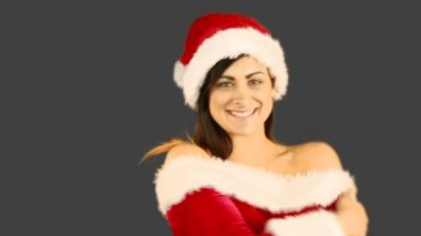 Smiling pretty woman posing in sexy santa outfit — Stock Video