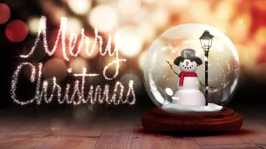 Snowman inside snow globe with christmas greeting — Stock Video