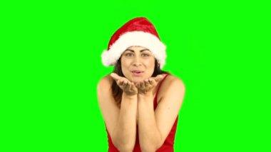 Pretty girl in santa hat sending an air kiss — Stock Video