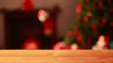 Empty table against blinking lights on christmas tree — Stock Video