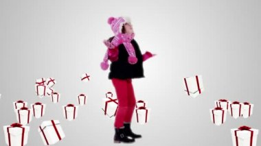 Festive little girl under falling christmas gifts — Stock Video