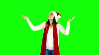 Woman in santa hat and warm clothing looking upwards — Stock Video