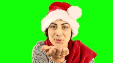 Pretty brunette in santa hat sending an air kiss — Stock Video