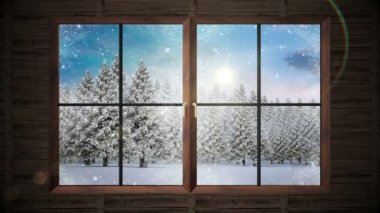 Window showing snow falling on fir tree forest — ストックビデオ