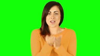 Happy brunette blowing over hands — Stock Video