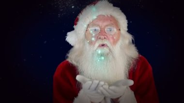 Santa blowing glitter forming christmas greeting — Stock Video