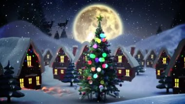 Flashing christmas tree in snowy village — Stockvideo
