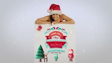Festive brunette presenting a christmas card — Stock Video