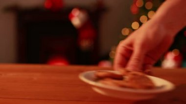 Hand leaving cookies and milk out for santa — Stock Video
