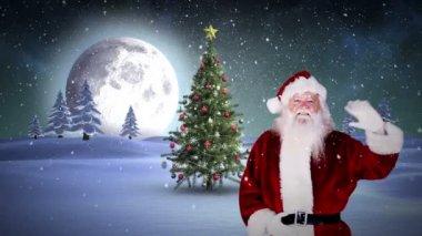 Santa waving at camera in snowy landscape — Stock Video