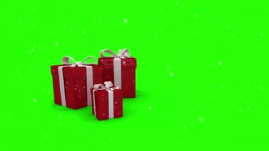 Red christmas presents appearing on green screen — Stock Video