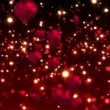 Red hearts floating against glittering background — Stock Video #62427709