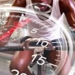Stopwatch graphic over man using exercise bike — Stock Video #62427737