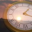 Clock ticking against sun setting — Stock Video #62428069