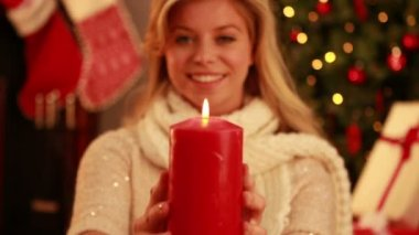 Pretty blonde holding candle at christmas — Stock Video
