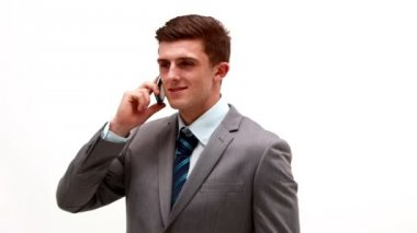 Businessman talking on phone white background — Stock Video