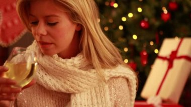 Pretty blonde sipping wine at christmas — Stock Video