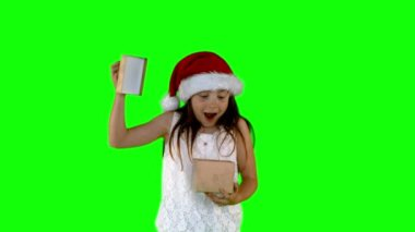 Festive little girl opening gift — Stock Video
