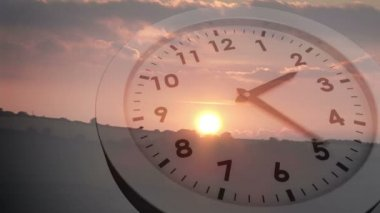 Clock ticking over sun setting — Vídeo Stock