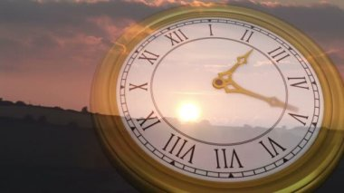 Clock ticking against sun setting — Vídeo Stock