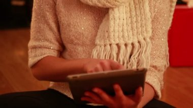 Pretty blonde using tablet at christmas — Stock Video