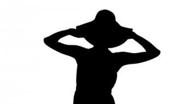 Woman wearing sunhat and sundress in black silhouette — Vídeo Stock