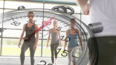 Stopwatch graphic over step aerobics class — Stock Video
