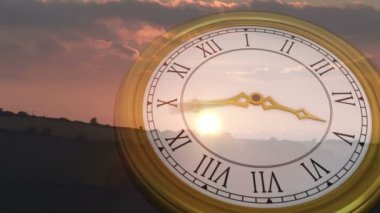 Roman numeral clock over sun set — Стоковое видео